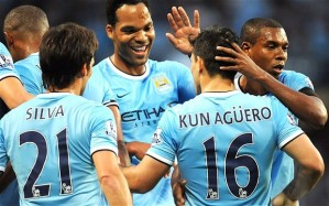 Manchester City players celebrating Aguero's goal.